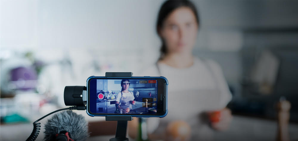 A chef live streaming in her kitchen